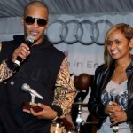 Shanti presents TI his award at ATL Live BET Awards Edition